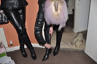 Girl-in-leather-pants-zipping-up-leather-boots