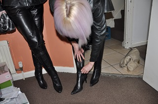 Girl-in-leather-pants-zipping-up-leather-boots.jpg