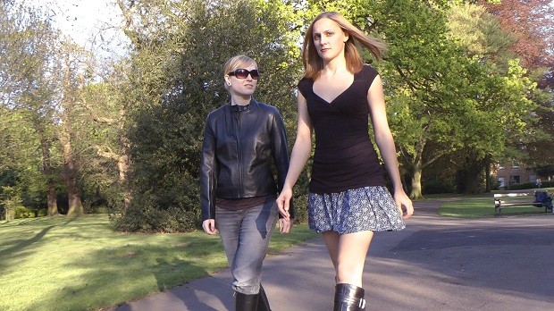 girls-in-leather-boots and-gloves-walking
