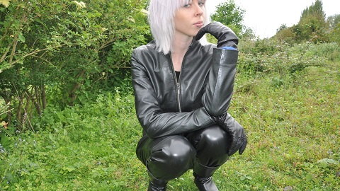 girls-in-leather-pants-leather-jacket-with-leather-boots-and-leather-gloves-railway