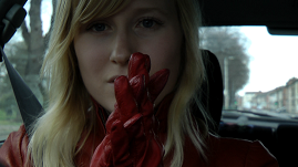 satin-girl-in-leather-gloves-and-jacket-driving-car